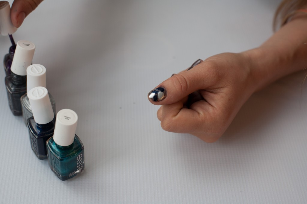 Apply splotches of all 5 of Essie No Place Like Chrome, Trophy Wife, Over the Top, Midnight Cami and Sexy Divide on the nails